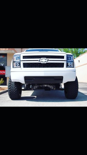 2015 Chevy Silverado with Mcgaughys Suspension truck lift kit installation in Melbourne FL Explicit Customs