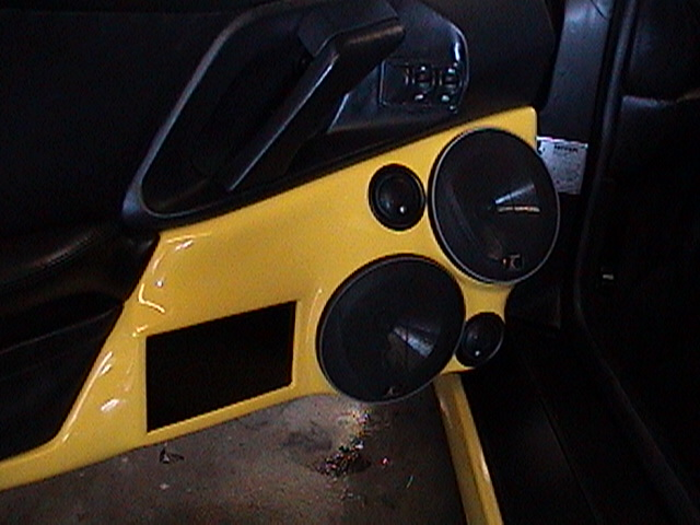 Ferrari F355 custom car stereo using kicker audio. Custom fiberglass enclosure and doors. Explicit Customs Melbourne Suntree Viera Florida