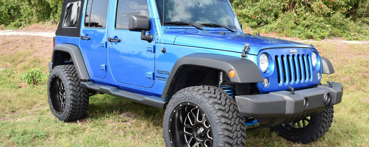 "2015 Jeep Wrangler with 3.5"" Rubicon lift kit, Fox shocks, Fox steering stabilizer, Fuel Grenade wheels, and 35"" Nitto tires"